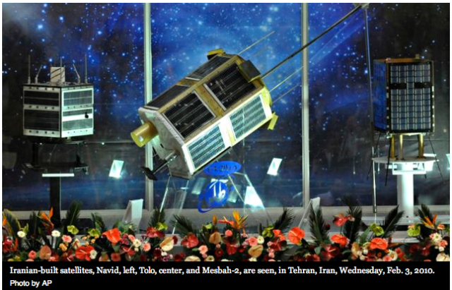 Iranian-built satellites, Navid, left, Tolo, center, and Mesbah-2, are seen, in Tehran, Iran, Wednesday, Feb. 3, 2010.